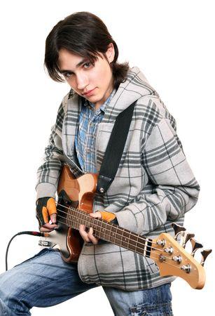 Young rock musician playing bass guitar  photo