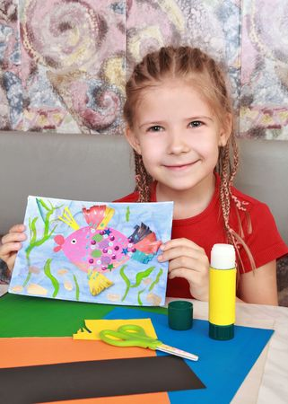 The girl made the applique featuring a magic fish