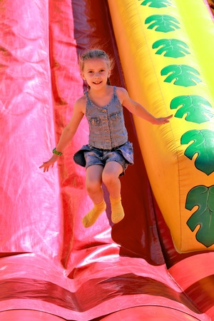 Girl jumping on inflatable attractions