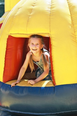 Girl playing on a trampoline photo