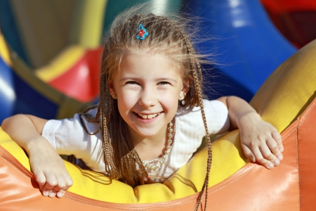 springy: Happy girl relaxing and having fun in a summer park  Stock Photo