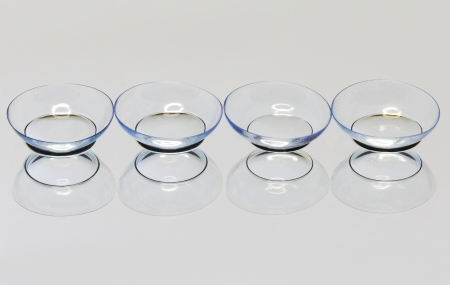 Four soft contact lens on the mirror surface  스톡 콘텐츠