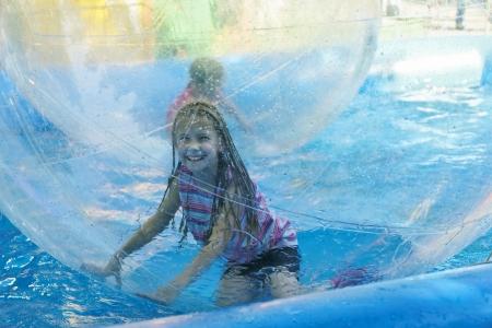 Girl on roller coaster aquazorbing   스톡 콘텐츠