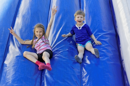 Funny kids and off the inflatable slides