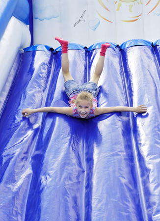 Girl with inflatable slides rolls  photo