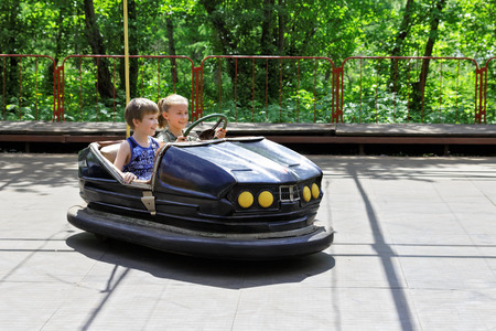 steers: Children at play in the attraction Autodrome