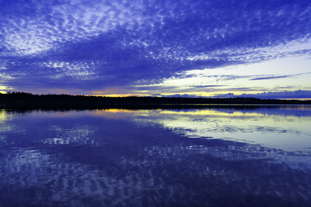 Sunset over the surface of the Siberian lake
