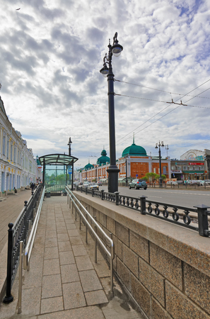 Editorial.Russia, Siberia, the city of Omsk, May 12. 2017. A wheelchair ramp from the stopping complex on Lenin street Editorial