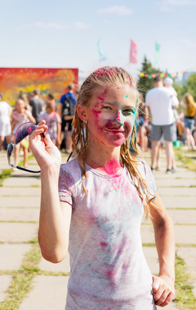 sprinkled: Joyful girl sprinkled with dry paint at the festival of paints