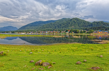Russia, Altai, view of the village Iogach at the mouth of Lake Teletskoye Stock Photo