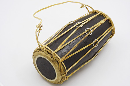 Mrdang - a two-membrane drum. It is widespread in the practice of playing the Karnat tradition in India