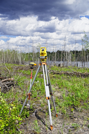 Worn an electronic total station and a GPS GLONASS receiver in the field in the forest