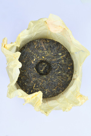 Traditional Chinese Puerh tea cake in the package