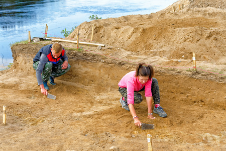 Archaeologists do a sweep of the treated soil during excavation Editorial