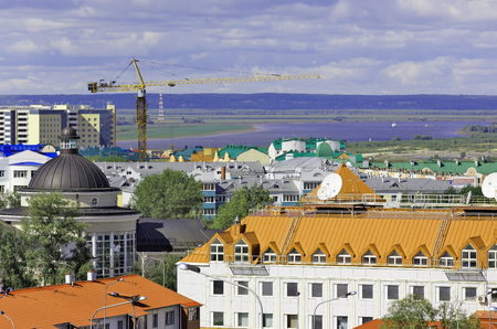 Khanty-Mansiysk, Russia. Top view of building roofs, in the background - the lifeless space of the river and taiga