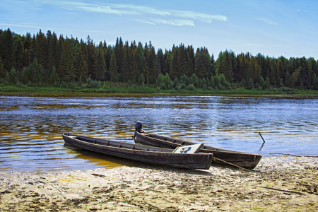 Unusual elongated wooden boats of the Mansi people in Siberia