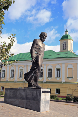 Monument to the Russian writer Dostoevsky in Omsk against the backdrop of the building of the guardhouse of the 18th century
