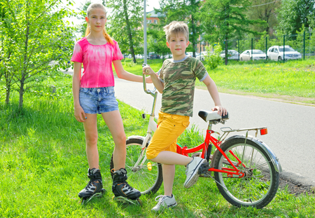 Adolescents are engaged in active sports in the summer park