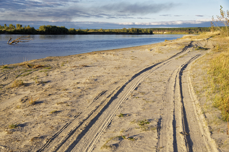 Sunset lighting of the autumn river bank in Siberia