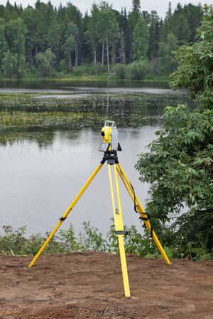 Geodetic GNSS receiver in the field , mounted on a tripod.
