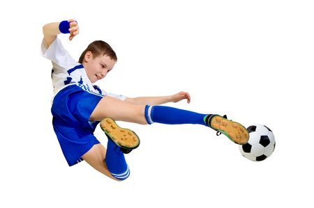 soccer uniforms: boy a footballer beating on a ball in a jump on a white background Stock Photo