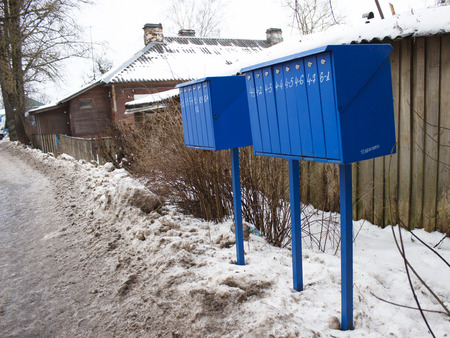 postmaster: Blue mailboxes on a village street in winter