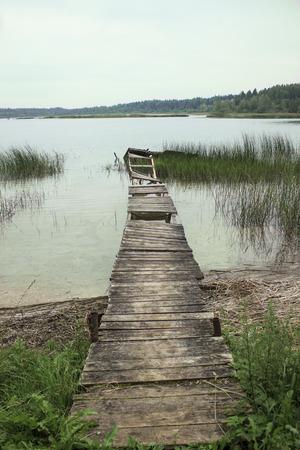 footbridges: Old broken footbridges at lake Stock Photo