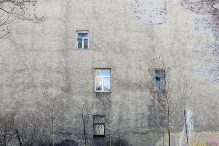 uncoordinated: The wall of the house with unordered windows