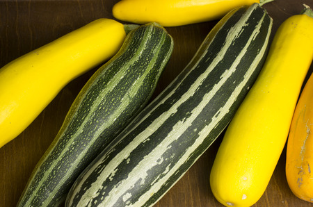 Several colorful courgettes lie on the table Stockfoto