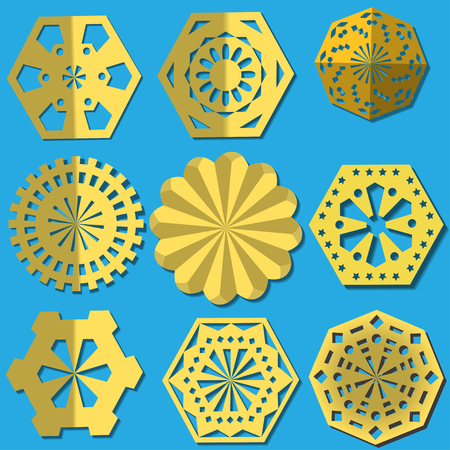 Golden snowflakes cut from foil. A set of different types