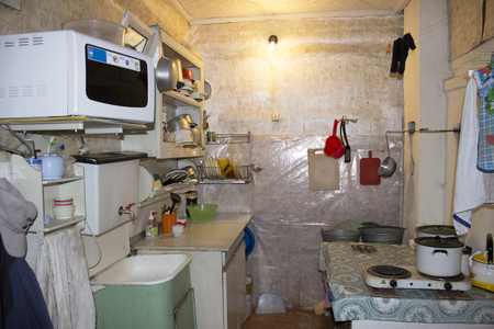 Kitchen interior with sink and dishes in an old Russian house