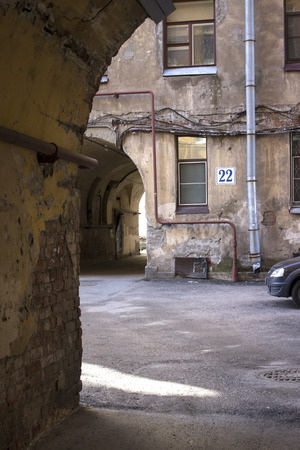Traditional courtyards of St. Petersburg, many arches and passages, stone shabby houses