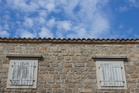 The windows on the facade of stone House Stock Photo - 15232385