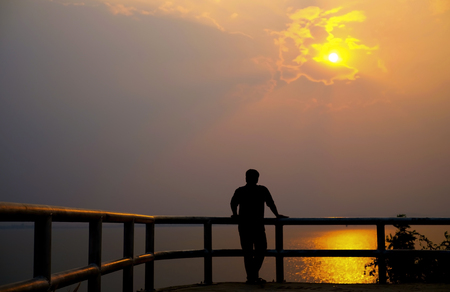 Silhouette of man on sunset. Element of design. Silhouette of man hand up on the top dam with the sunset.