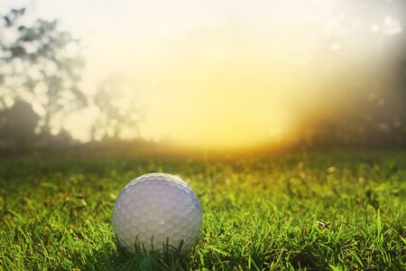 Golf balls on green lawns in beautiful golf courses with sun rise background.Important equipment to play golf.Sports that people around the world play during the holidays for health.