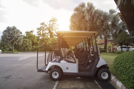 Electric golf cars parked in an orderly manner at the parking lot. Ready for service to golfers who practice or play golf competitions.