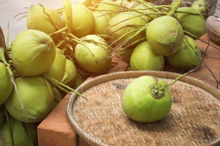 Coconut on a bamboo tray.Tropical fruit used to make coconut milk. 版權商用圖片