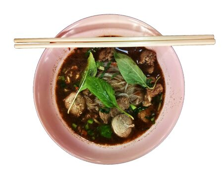 Meatball noodles in a top view cup isolated on a white background with clipping paths for graphic design.Popular Thai food that Asian people love