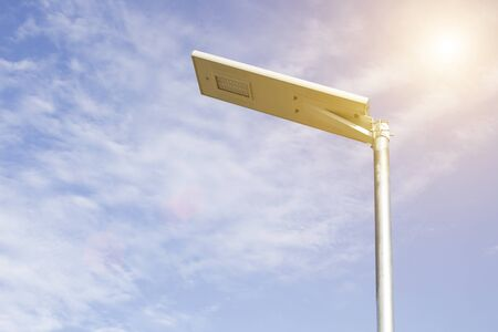 Electric poles illuminated with solar cells and clear blue sky for sidewalks or parks. Devices that help save electricity and conserve the environment, including saving costs Standard-Bild