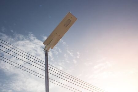 Electric poles illuminated with solar cells and clear blue sky for sidewalks or parks. Devices that help save electricity and conserve the environment, including saving costs Standard-Bild - 147344818