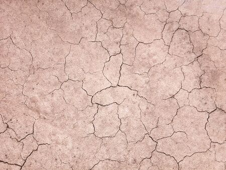 The ground has cracks in the top view for the background or graphic design with the concept of drought and death.