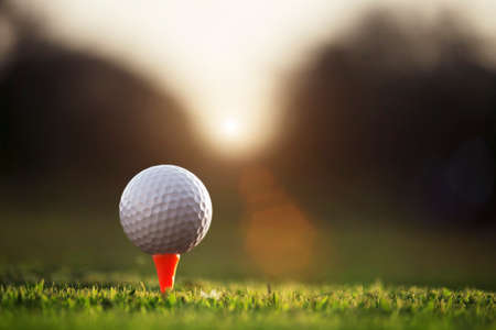 golf ball on tee in a beautiful golf course with morning sunshine.Ready for golf in the first short.Sports that people around the world play during the holidays for health. Фото со стока