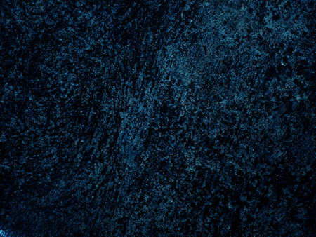 Dark rough cement wall background for graphic design or wallpaper. Grungy black and blue concrete texture in vintage style. The old plaster floor has a mysterious and terrifying age. Standard-Bild