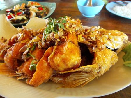 engraulis: fried fish garlic Stock Photo