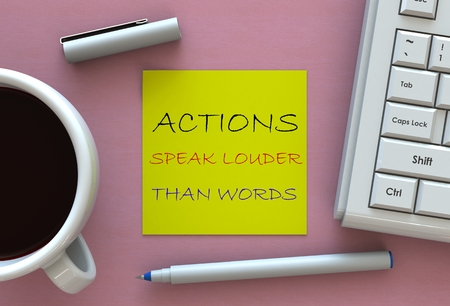 louder: ACTIONS SPEAK LOUDER THAN WORDS, message on note paper, computer and coffee on table Stock Photo