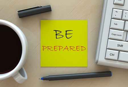 be prepared: BE PREPARED, message on business note paper, computer and coffee on table Stock Photo