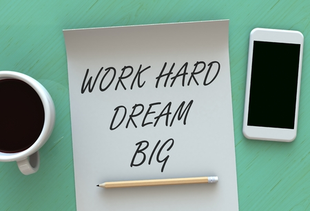 hard day at the office: Work Hard Dream Big, message on paper, smart phone and coffee on table