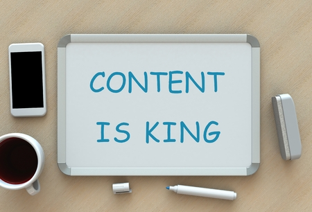 news values: CONTENT IS KING, message on whiteboard, smart phone and coffee on table