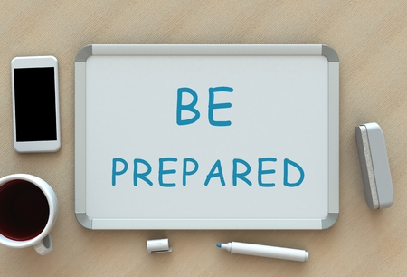 be prepared: BE PREPARED, message on whiteboard, smart phone and coffee on table Stock Photo