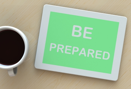 be prepared: BE PREPARED, message on tablet and coffee on table Stock Photo